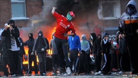 Hooded youths rioting