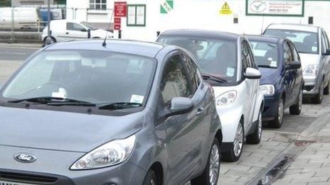 Cars parked on the pavement in Portland Street, Aberystwyth