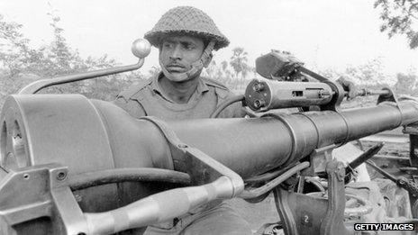 A soldier manning a gun