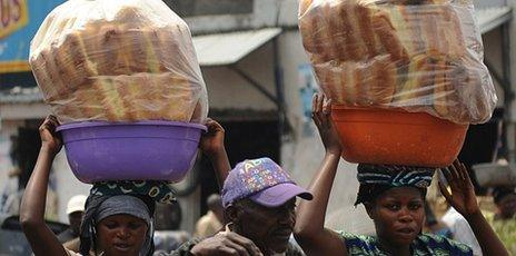 Congolese women sell bread in the streets of Goma on 5 December 2011
