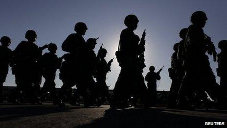 Soldiers walk in formation during the inauguration of military barracks in Ciudad Mier in Tamaulipas state December 2011.