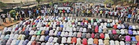 Muslims pray while Christians form a protective human chain around them during a protest against the elimination of a popular fuel subsidy that has doubled the price of petrol in Nigeria's capital Abuja, January 10, 2012.