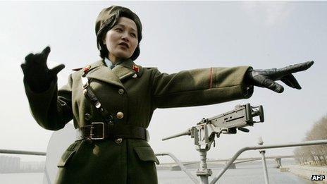 A North Korean guide shows tourists around the USS Pueblo
