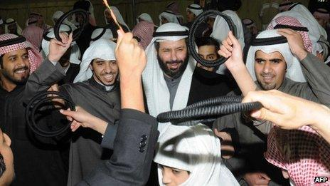 Kuwaiti opposition candidate Faisal al-Mislem celebrates with his supporters (3 February 2012)