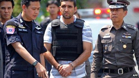 Thai police escort suspect Mohamad Khazaei to the scene of the first blast in Bangkok, 20 February