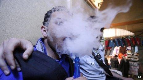 Iraqis who identify as emos smoke a water pipe in Najaf
