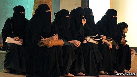 Saudi women waiting for their drivers outside a mall in Riyadh