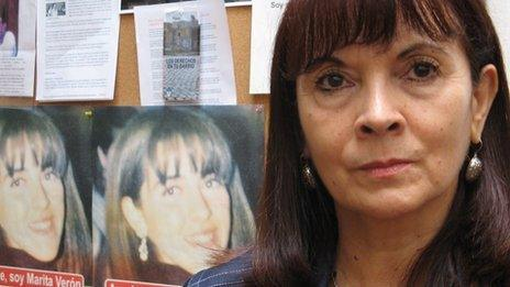 Susana Trimarco in front of pictures of her daughter known as Marita