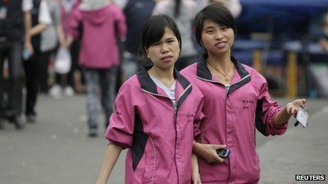 Employees wearing Foxconn uniforms during their lunch break in Shenzhen