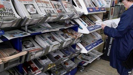 Headlines on British newspapers at a newsagent shop in London