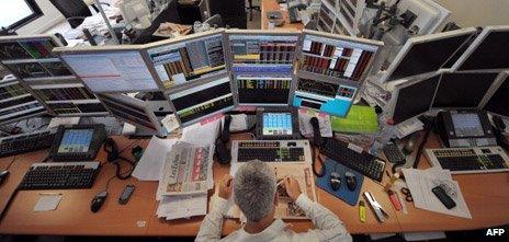 Trader with computers