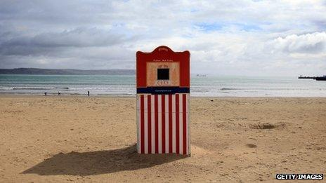 A Punch and Judy traditional puppet show theatre is set up on the seafront of Weymouth Bay, which will be the venue for the London 2012 Olympic and Paralympic Sailing competitions on April 18, 2012 in Weymouth, England