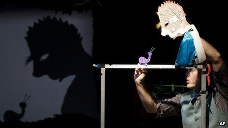 Canadian performance artist, Jeff Achtem, performs Swamp Juice, the show which features over 60 shadow puppets which include snails, mice and a swamp monster, at the Soho Theatre, London, Tuesday, April 17, 2012