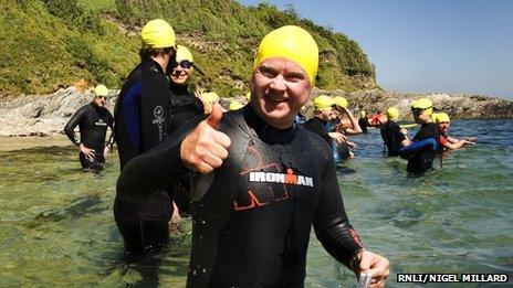Steve McFadden taking part in the Castle to Castle swim for the RNLI