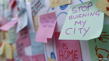 """Post-It messages about last summer's riots such as """"Stop burning my city"""""""