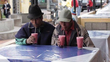 Mr Ushca and Juan enjoy a fruit juice