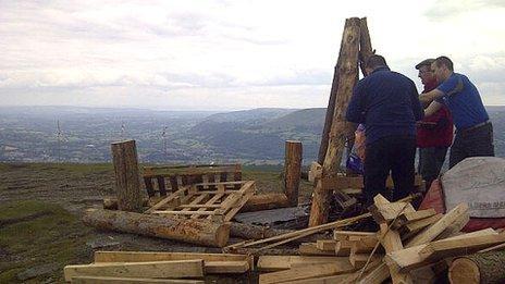 Longtown Mountain Rescue Team building a beacon on Sugar Loaf mountain, Abergavenny.
