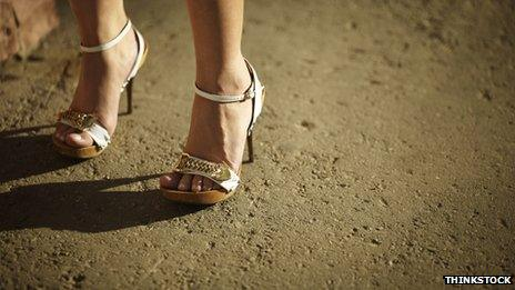Woman's feet wearing high heels
