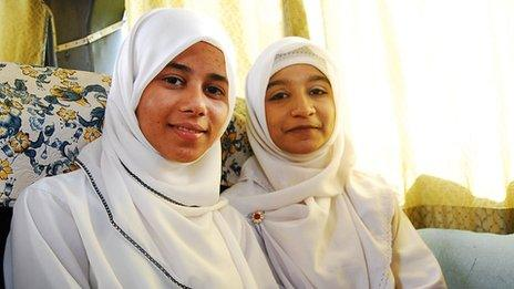 Sharifah binti Hussein (L), with a friend