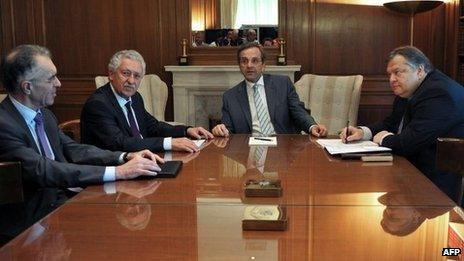 Greece's Prime Minister Antonis Samaras (C), Leader of the Democratic Left party Fotis Kouvelis (2nd L), Foreign Minister Vassilis Rapanos (L) and leader of Pasok Evangelos Venizelos (R) meet at the prime minister's office on June 21, 2012