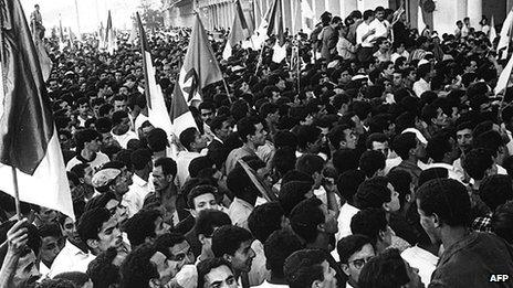 Crowds cheer Ben Khedda, premier of the provisional government of the newly independent Algeria