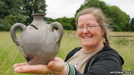 Nancy Grace holding the grenade