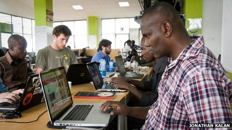 A man uses a laptop at iHub in Kenya