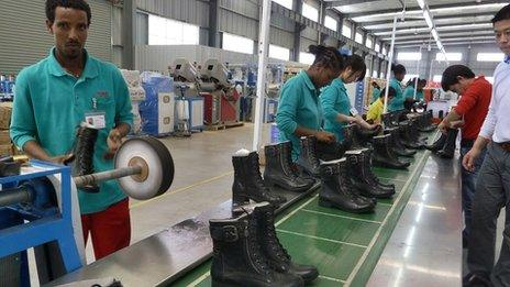 People working at an assembly line at the Huajian shoe factory in Dukem, Ethiopia