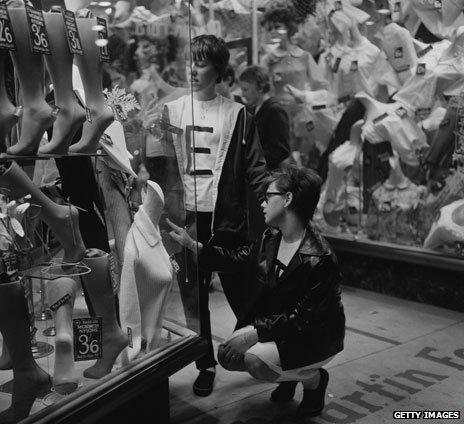 Looking in a shop window in London, 1964