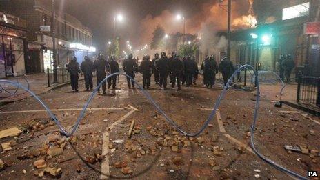 Riot police on devastated street