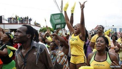 Jamaicans celebrate after Usain Bolt's success in men's 100m