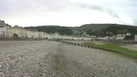Stones and seaweed on Llandudno North Shore beach