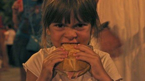 Girl eating sandwich (Image: Tamsin Smith)