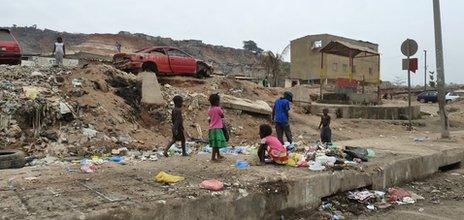 Children playing amongst rubbish about two miles from the centre of Luanda, Angola