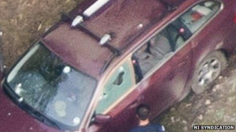 Also inside the car is Zainab's four-year-old sister Zeena, who is hiding in the back of the car under the legs of the dead women. French police on the scene are told not to disturb the crime scene and do not open the doors for fear of shattering the glass which has bullet holes in it.