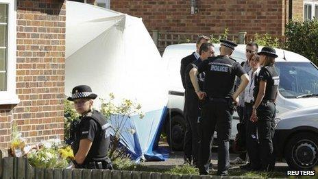 French police speak to their British counterparts outside the home of Saad al-Hilli in Surrey