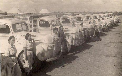Women lined up with their trucks