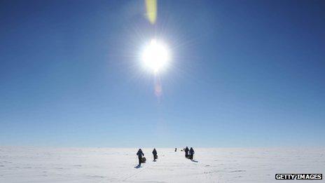 Explorers on skis in Antarctica