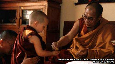 Osel as a young boy with the Dalai Lama