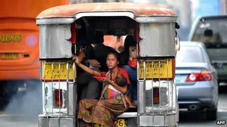 Homeless mother with child on a jeepney in Manila (Dec 20110