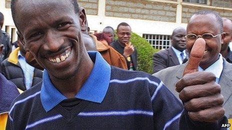 Ezekiel Kemboi gives the thumbs up outside Eldoret court in Kenya on 25 September 2012