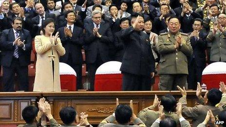 North Korean leader Kim Jong-un (C), with his wife Ri Sol-ju wearing a beige coat, watching a concert in Pyongyang, 29 October 2012