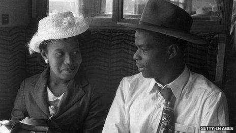 West Indian immigrants aboard a train in the 1950s