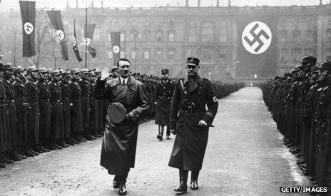 Hitler walking through a guard of honour