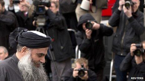 Abu Qatada arrives back at his home in London