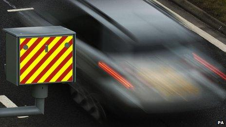 A driver passes a speed camera