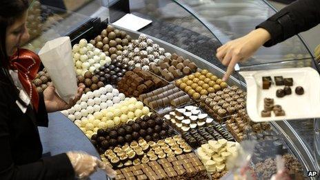 Visitors taste different sorts of chocolate at the International Salon des Chocolatiers et du Chocolat, in Geneva, Switzerland