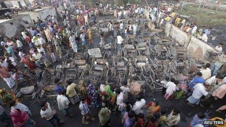 residents of the slum outside Dhaka mourn the dead