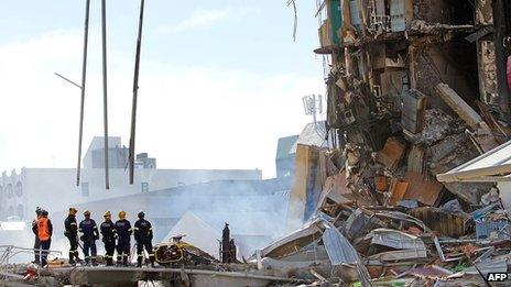 Rescuers at the smoking ruins of the CTV building on 24 February 2011