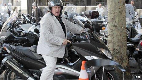 File pic from May 2011 of Gerard Depardieu on a motorbike in PAris